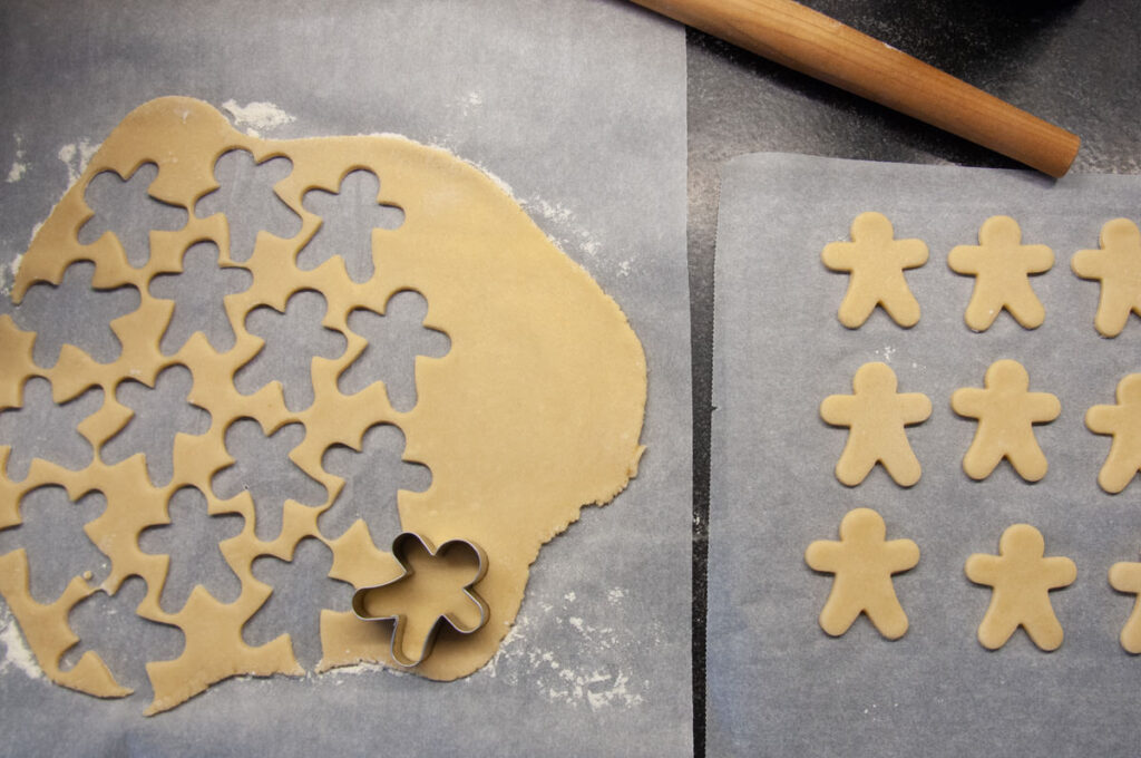 cutting out almond sugar cookies