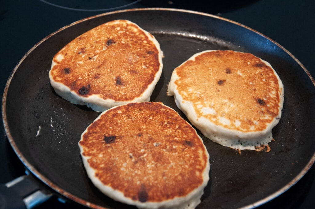 chocolate chip pancakes in pan