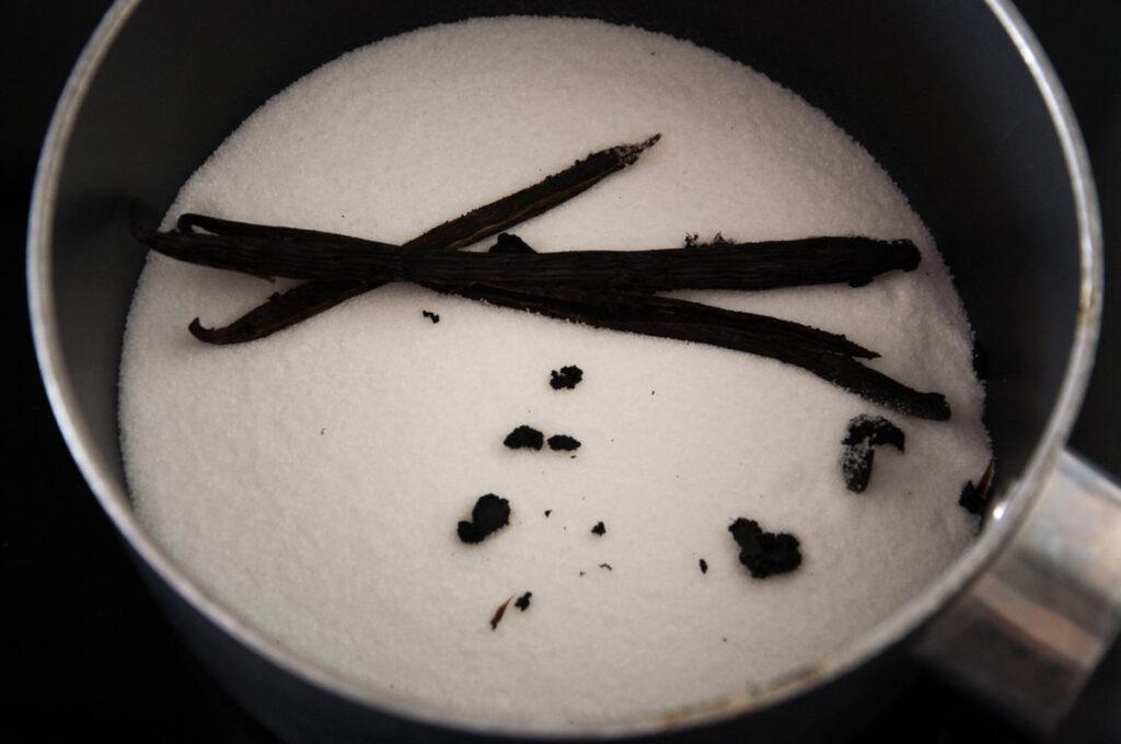 vanilla beans and sugar in pot