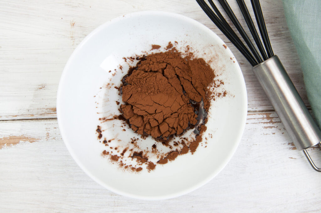 oil and cocoa powder in bowl